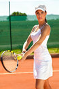 Female tennis player at court Royalty Free Stock Photos