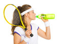 Female tennis player drinking water isolated on white Stock Image