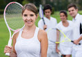 Female tennis player with her team holding racket at the background Stock Photos