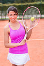 Female tennis player holding a racket at the court Royalty Free Stock Photos