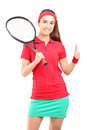 Female tennis player holding a racket and giving a thumb up Royalty Free Stock Images