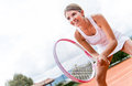 Female tennis player holding a racket outdoors Stock Image