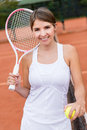 Female tennis player looking happy at the court Royalty Free Stock Photo