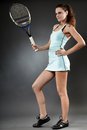 Female tennis player with racket full length portrait of a holding the Royalty Free Stock Photos