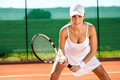 Female tennis player waiting for a service Royalty Free Stock Photos