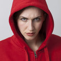 Female threat concept for angry 20s streetwear girl Royalty Free Stock Photo