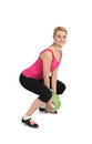 Female throwing medicine ball exercise phase of with squatting before throw Stock Photos