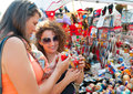 Female tourists choosing souvenirs Royalty Free Stock Image