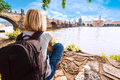 Female traveler enjoys views of the Charles Bridge in Prague
