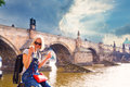 Female traveler enjoys views of the Charles Bridge in Prague