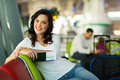 Female traveller airport attractive waiting for her flight at Royalty Free Stock Image