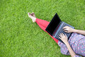 Female using laptop outdoor Royalty Free Stock Images