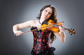 Female violin player on the background Stock Images