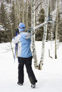 Female walking with skis. Royalty Free Stock Photos