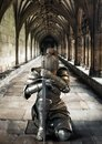 Female warrior knight kneeling proudly wearing decorative metal armor and holding a sword. Royalty Free Stock Photo