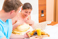 Female was pleasantly surprised by breakfast in bed Royalty Free Stock Photography