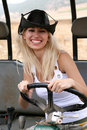 Female wearing cowboy hat riding quad Stock Photography