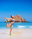 Female wearing diving equipment cute happy woman goggles and flippers having fun on the beach raised up hands exotic summer Royalty Free Stock Images