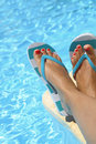 Female wet feet with flip flops by the pool Royalty Free Stock Photography