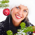 Female in winter cap by a Christmas tree Stock Photo