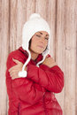 Female in winter wear appears cold hugging herself eyes closed Stock Photography