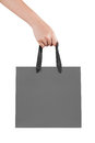 A female woman hand hold a gray shopping bag paper bag at the and strings studio Stock Image