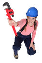 Female worker holding wrench Royalty Free Stock Image