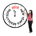 Female worker makes resolution clock portrait of young businesswoman a big with new year s text Stock Photo