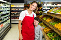 Female worker posing with little boy Royalty Free Stock Photo