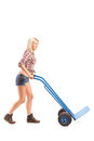 Female worker pushing an empty hand truck Stock Photography