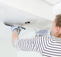 Female worker repairs gypsum plasterboard frame with spackling paste Stock Images