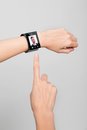 Female wrist with a modern internet smart watch arm on grey background on the screen you can see videochat all texts icons Stock Photos