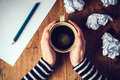 Female writer drinking cup of coffee Royalty Free Stock Photo