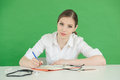 Female writing in journal Royalty Free Stock Photo