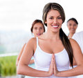 Female yoga instuctor looking very happy in a class Royalty Free Stock Photos
