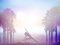 Female in yoga pose in summer palm tree landscape with retro eff silhouette of a effect Stock Photography