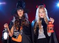 Females with lanterns portrait of two halloween girls looking at camera Royalty Free Stock Image