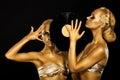 Fetish. Women DJs holding Retro Vinyl Record. Fantastic Gold Badyart. Performance Royalty Free Stock Photo