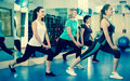 Females working out at aerobic class in modern gym Royalty Free Stock Photo