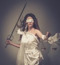 Femida goddess of justice with scales and sword wearing blindfold Stock Image