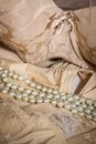 Feminine bra and beige underclothes background with perlas Royalty Free Stock Images
