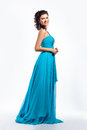 Feminine. Graceful happy woman in blue dress Royalty Free Stock Photos