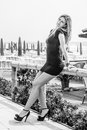 Feminine seduction. Blonde model girl outdoors. Black and white. Royalty Free Stock Photo