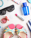 Feminine summer set of accesories women s accessories sunglasses shoes slippers passport blue striped bag pink lipstick blush Royalty Free Stock Image