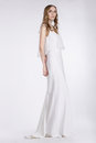 Femininity cute young woman standing in white dress Royalty Free Stock Photography