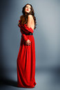 Femininity fashion shot of a gorgeous young woman in elegant red dress Royalty Free Stock Photos