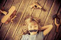 Feminism hipster kid with vintage wooden toys at home girl power and concept Stock Photography