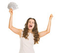Femme heureuse avec le fan des dollars se réjouissant le succès Photographie stock libre de droits