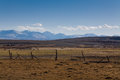 Fence on the background of the high snowy mountains Royalty Free Stock Photo