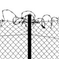 Fence with barbed wire Stock Photography